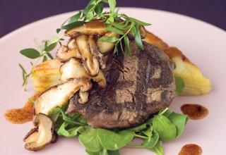 Grilled Bison Tenderloin, Potato Flan and Shiitake Mushroom Vinaigrette with Fresh Arugula by Chef Ben Kramer of Lux Solé