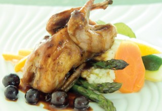 Pan-Roasted Quail with Black Currant Demi Glace, Vegetables and Arugula by Chef Lorna Murdoch of fusion grill