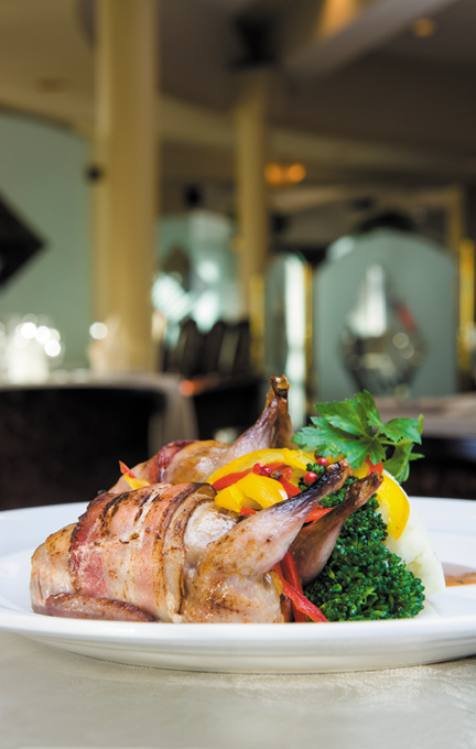 Italian sausage-stuffed quail wrapped in smoked bacon at Amici